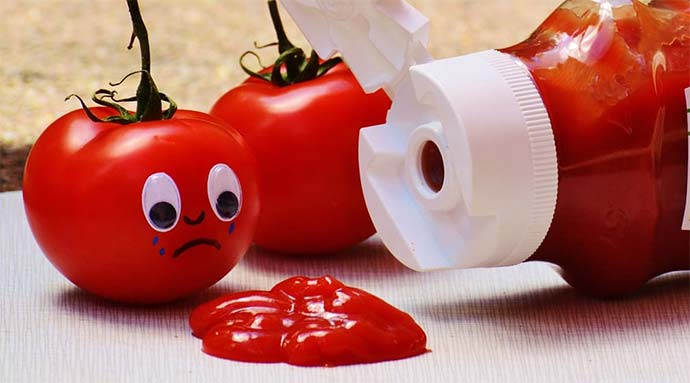 sad tomatoes with ketchup spillage